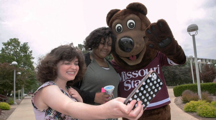 Boomer with students