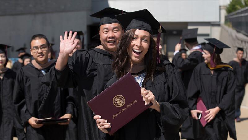 Graduates walk out of JQH Arena