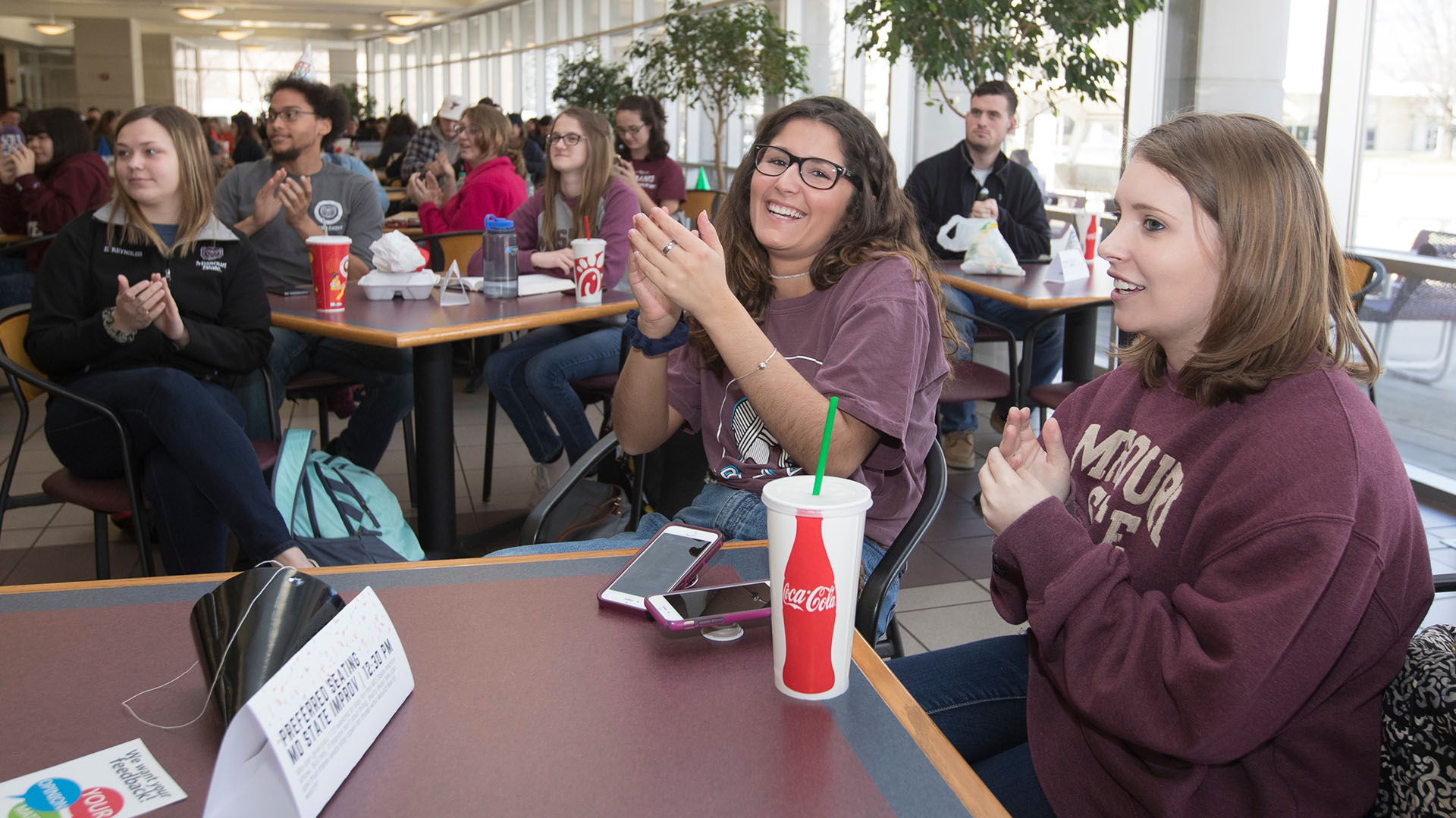 New media specialist interns, Mary Kay Gagnepain and Abby Blaes, laughing in the PSU at Missouri State's 113th birthday party.